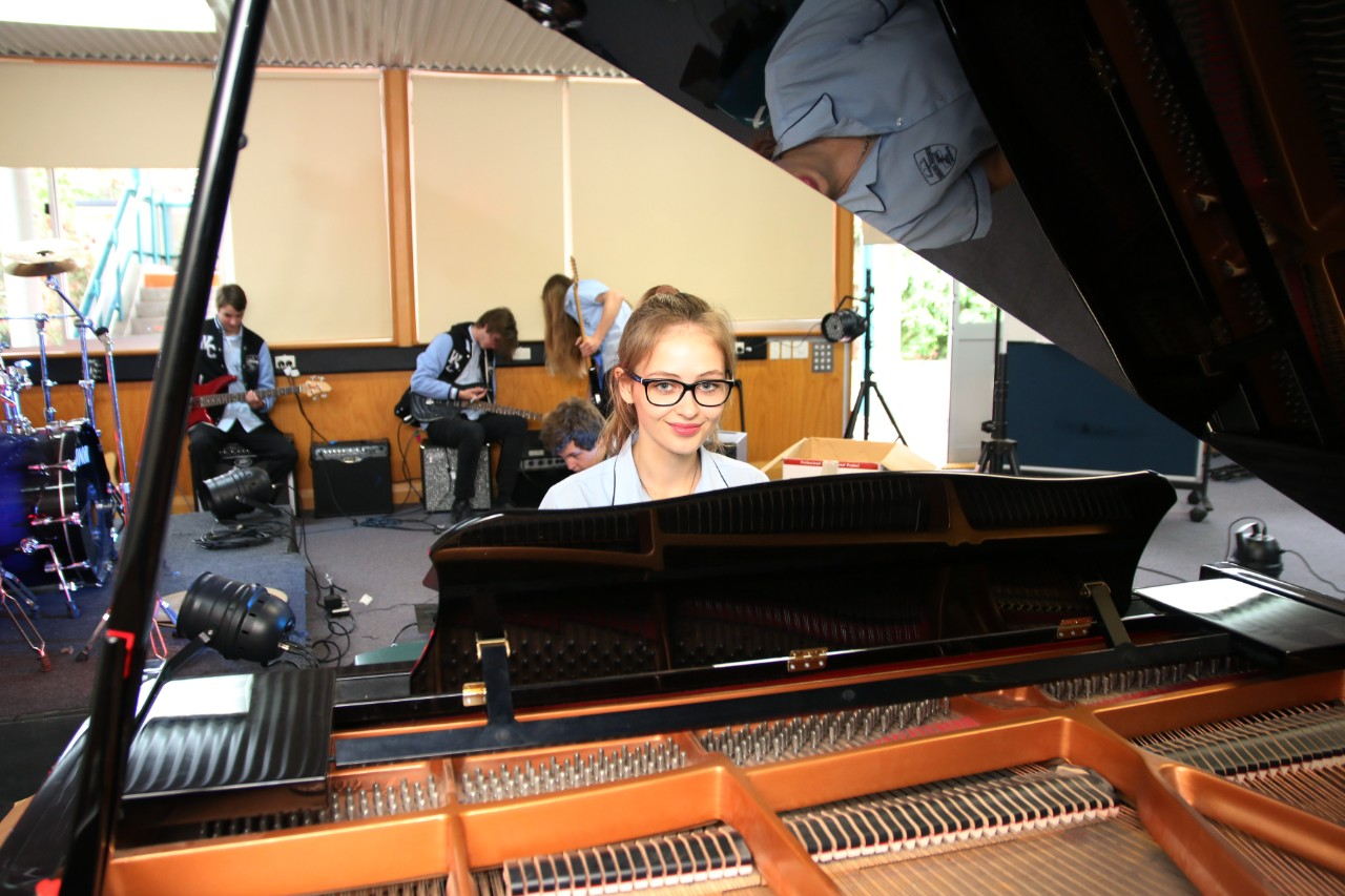 a student playing the piano