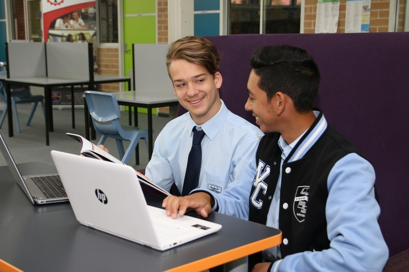 Boys using a laptop