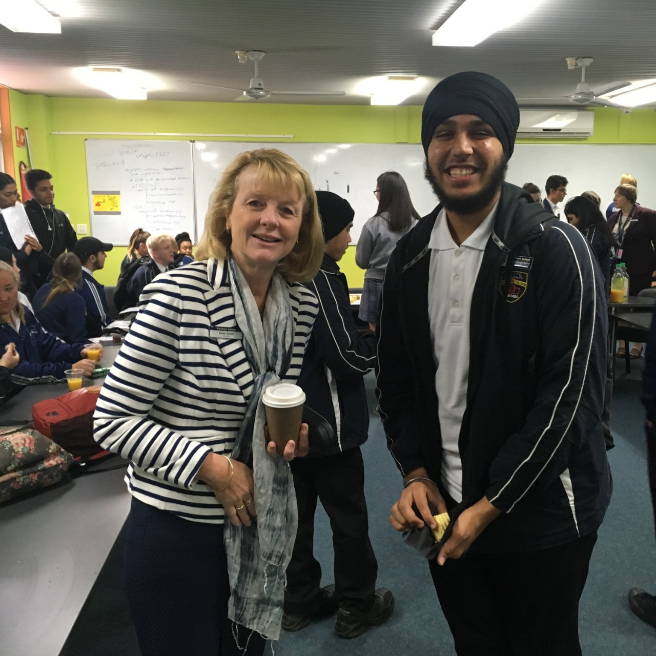 Principal with student at the morning tea